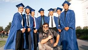 Actor Jack Black joins graduates during photoshoot