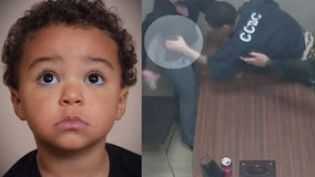 Video shows murder suspect lunging for officer's gun after police say he confessed to killing toddler