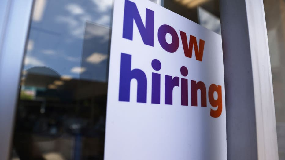 LOS ANGELES, CALIFORNIA - JUNE 23: A 'Now hiring' sign is displayed at a FedEx location on June 23, 2021, in Los Angeles, California. (Photo by Mario Tama/Getty Images)
