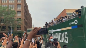 Before championship parade, Bucks fans try to get sneak peek at team