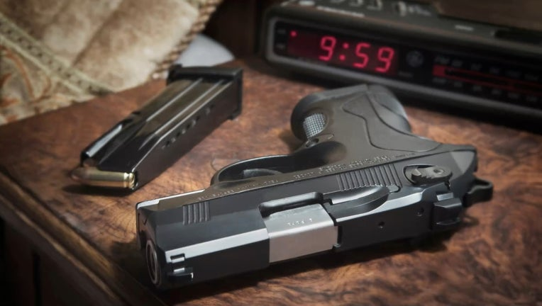 UntitledBerreta 9mm PX4 Storm semi-automatic pistol on bedside nightstand