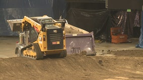 Gearing up for Monster Jam: A dirty job, but someone has to do it