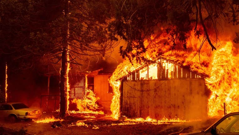 FILE - A home is engulfed in flames as the Dixie fire rages on in Greenville, California on August 5, 2021. (Photo by JOSH EDELSON/AFP via Getty Images)