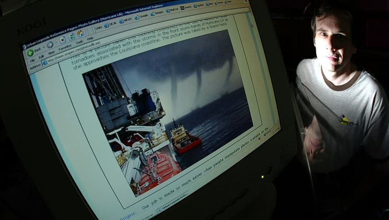 David Mikkelson next to his computer monitor with a doctored storm photo in which two extra tornados