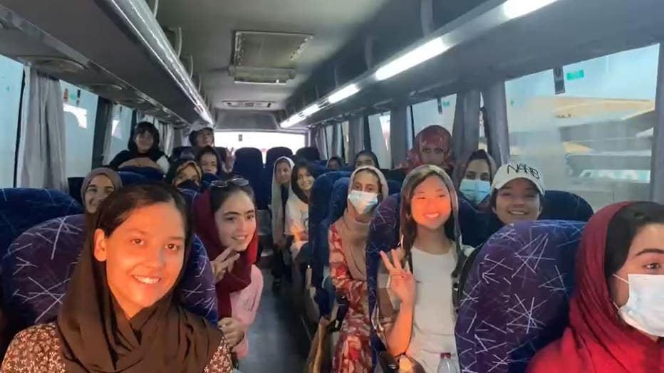 Afghan girls robitcs team on bus