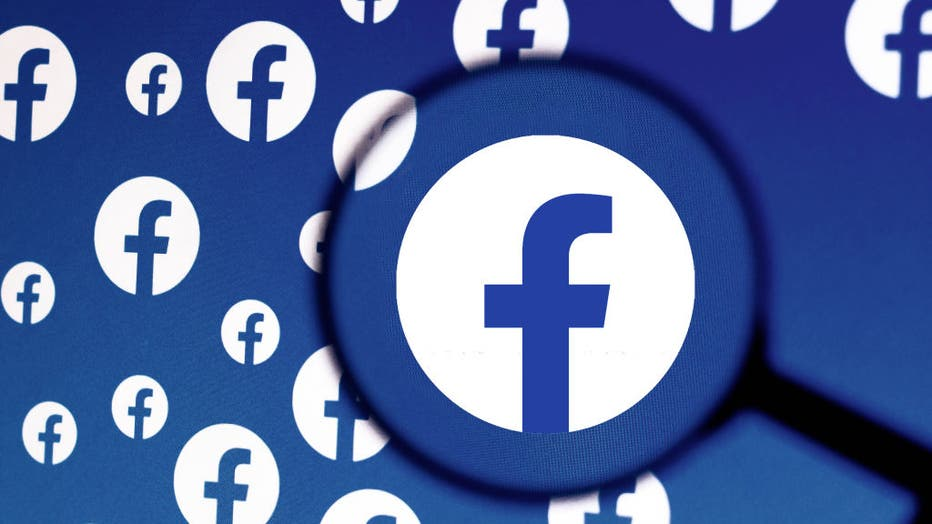 In this photo illustration a Facebook logo is seen on a