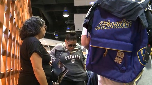 Brewers fans buy championship merchandise at Team Store