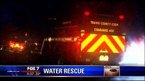 Woman rescued after car swept away in flood waters