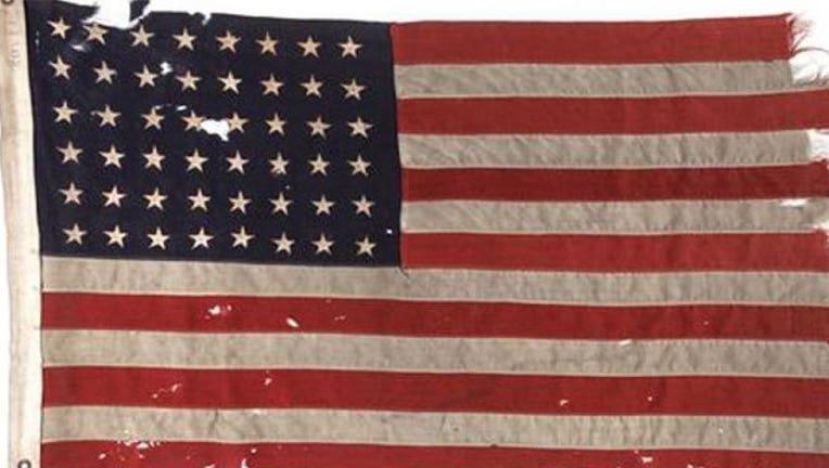 daacf5f9-D-Day-flag_1465774123069.jpg