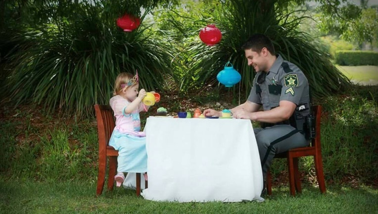 Deputy and daughter sit down to tea-401385