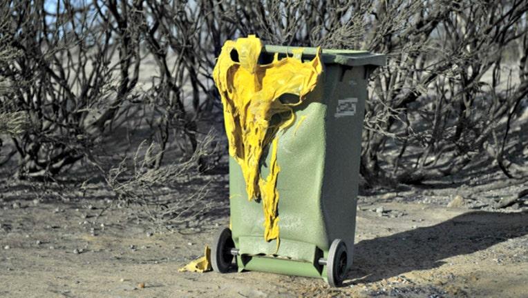 cdb19891-GETTY trash man burnt melted 3_1551223898027.jpg-404023.jpg