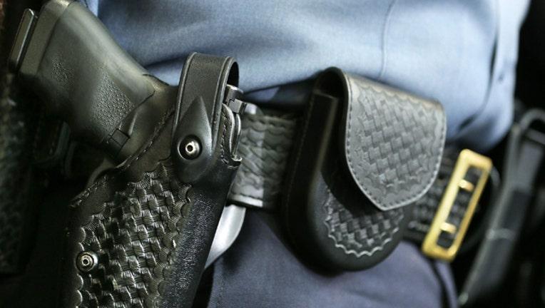 63c54a96-GETTY_gun and holster_1525726876409.jpg.jpg
