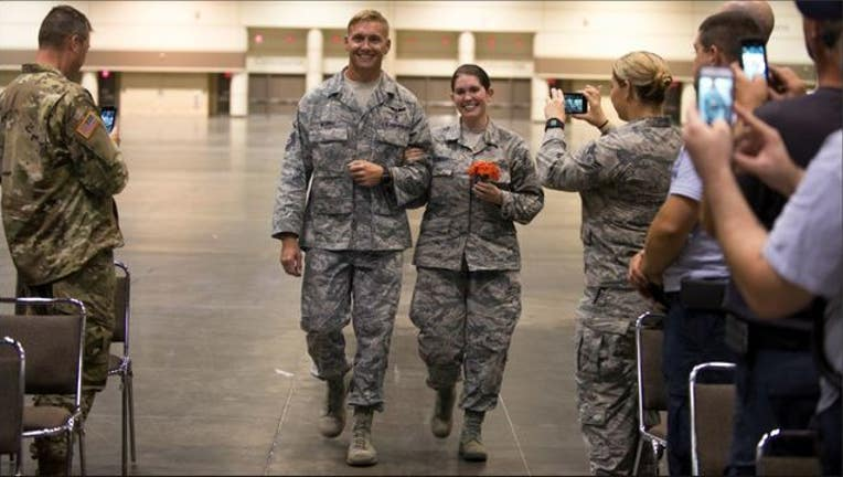 Florida National Guard Senior Airmen Lauren Durham and Michael Davis exchanged vows in Orlando before helping with hurricane recovery-404023