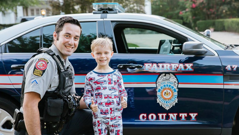 4997ab82-Police surprise boy at his birthday party-401720
