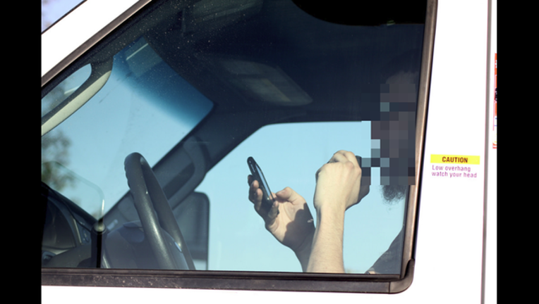 driving with phone_1494806683941-407068.png