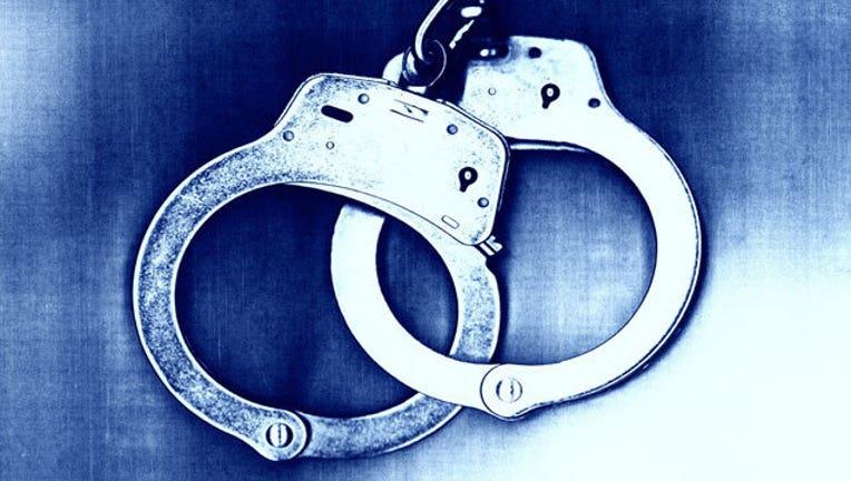 35694d64-handcuffs_1445216496928.jpg