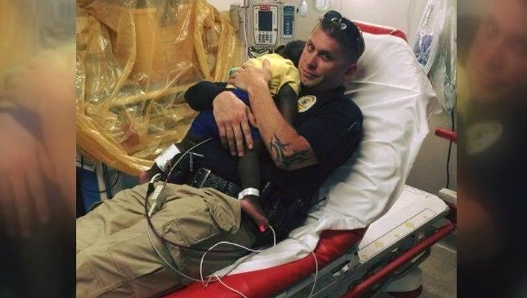 cdf15a31-officer comforts child_1462968567113-404959.jpg