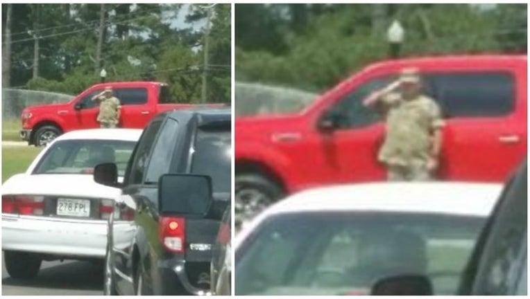 61730e91-soldier salutes flag_1474453764049-404959.jpg