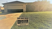 North Port police place yard sign announcing closure of alleged drug house