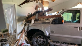 Truck drives into house in North Austin