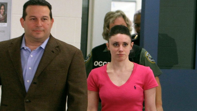 Attorney Jose Baez escorts Casey Anthony as she leaves the Orange County Corrections Facility on July 17, 2011, in Orlando, Fla. (Red Huber/Orlando Sentinel/MCT)