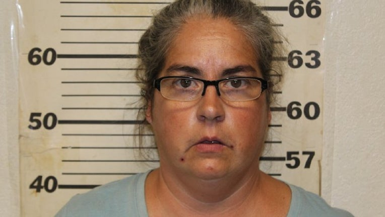 Tiffany Woodington, 49, was charged with 10 counts of felony animal abuse and two misdemeanor counts of animal abuse.