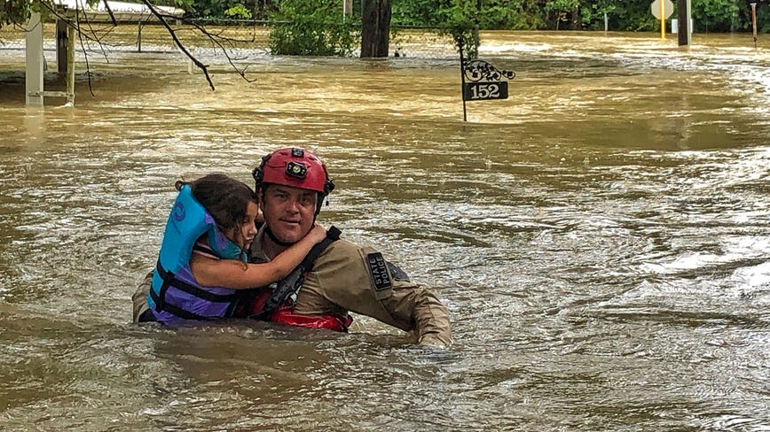 Texas Game Wardens and neighbors rescue families hit by Tropical Depression Imelda in Conroe