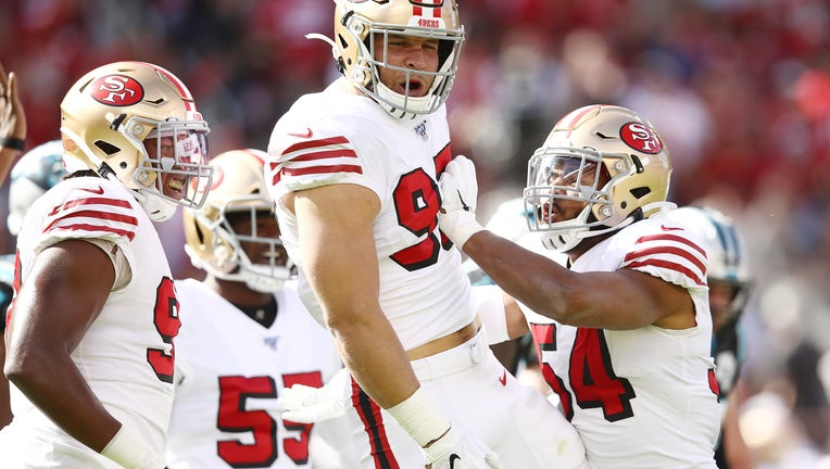 SANTA CLARA, CALIFORNIA - OCTOBER 27: Nick Bosa #97 of the San Francisco 49ers celebrates after sacking Kyle Allen #7 of the Carolina Panthers (not pictured) during the first quarter at Levi's Stadium on October 27, 2019 in Santa Clara, California. (Photo by Ezra Shaw/Getty Images)