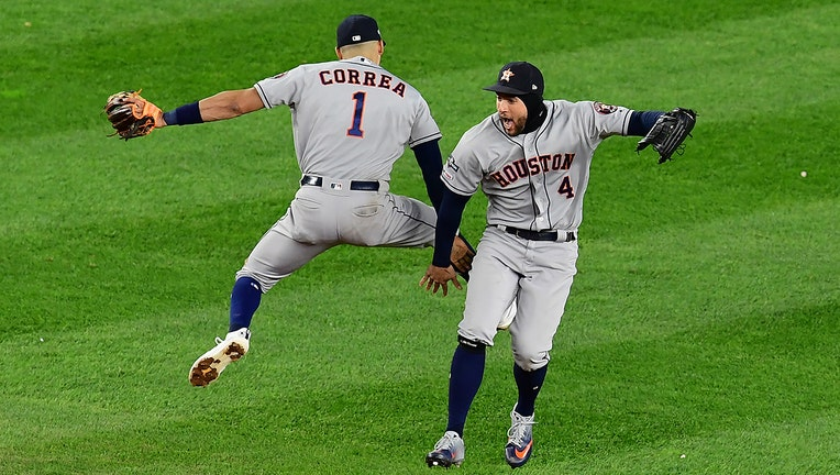 NEW YORK, NEW YORK - OCTOBER 17: Carlos Correa #1 and George Springer #4 of the Houston Astros celebrate an 8-3 win of game four of the American League Championship Series against the New York Yankees at Yankee Stadium on October 17, 2019 in the Bronx borough of New York City. (Photo by Emilee Chinn/Getty Images)