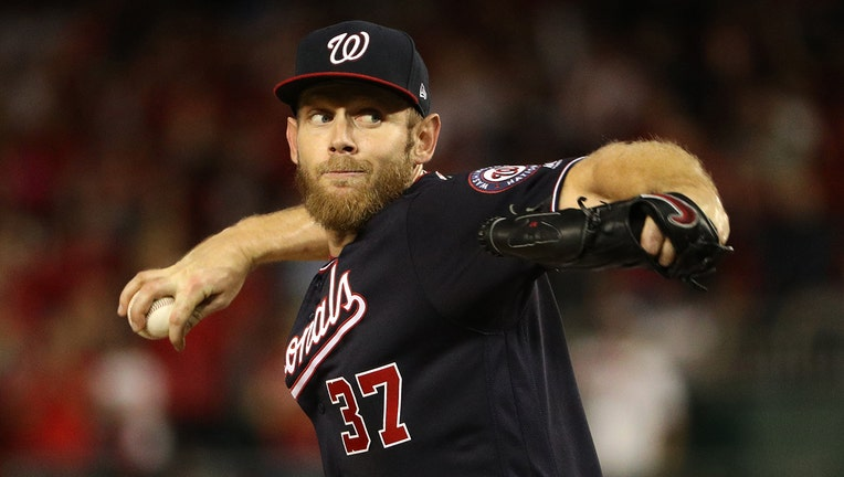 WASHINGTON, DC - OCTOBER 14: Stephen Strasburg #37 of the Washington Nationals pitches in the seventh inning of the game three of the National League Championship Series against the Washington Nationals at Nationals Park on October 14, 2019 in Washington, DC. (Photo by Patrick Smith/Getty Images)