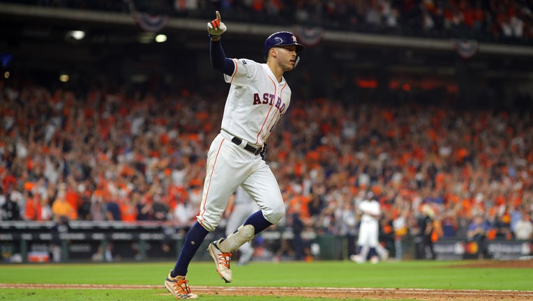 HOUSTON, TX - OCTOBER 13: Carlos Correa #1 of the Houston Astros rounds the bases after hitting a walk off home run in the 11th inning to beat the New York Yankees in Game 2 of the ALCS at Minute Maid Park on Sunday, October 13, 2019 in Houston, Texas.