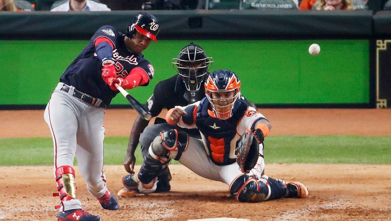 HOUSTON, TEXAS - OCTOBER 22: Juan Soto #22 of the Washington Nationals hits a two-RBI double against the Houston Astros during the fifth inning in Game One of the 2019 World Series at Minute Maid Park on October 22, 2019 in Houston, Texas. (Photo by Tim Warner/Getty Images)