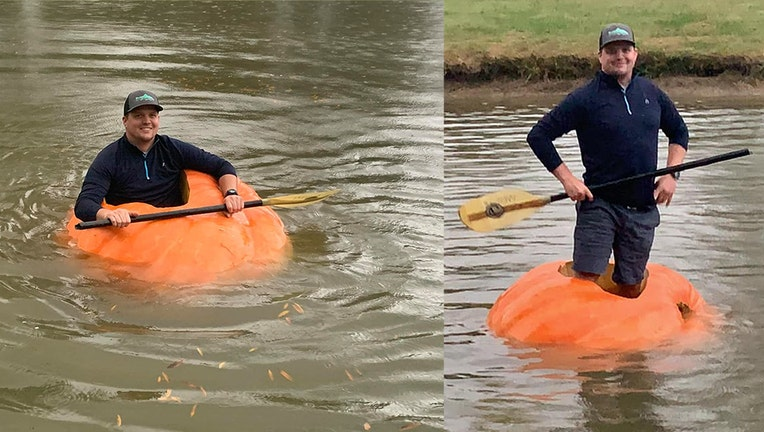 Justin Ownby's wife photographed him paddling in his 910-pound boat.