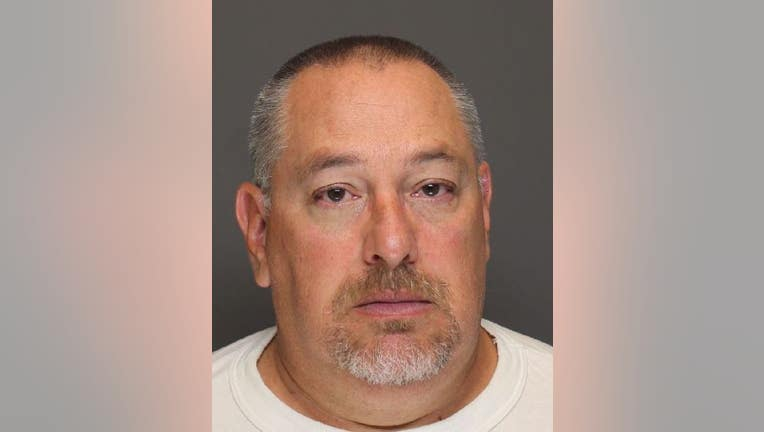 3b0db971-Randy Beehler, 53, is charged with third and fourth degree criminal sexual conduct for allegedly sexually assaulting an inmate he was transporting.