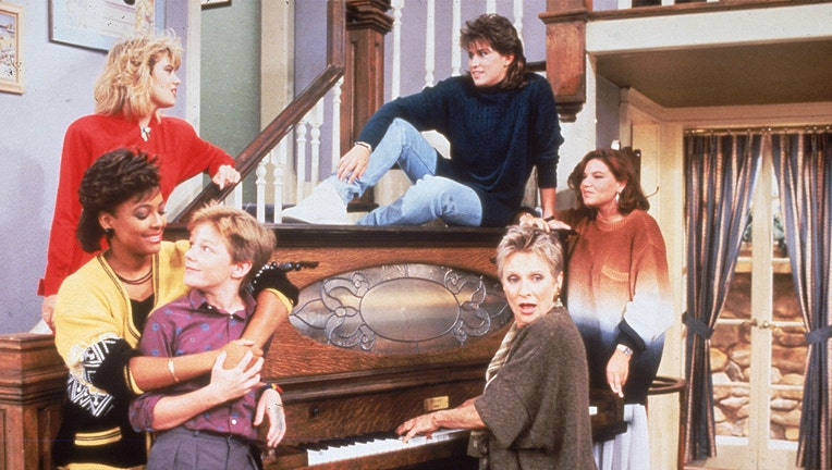 Cast members from the television series 'The Facts of Life' stand around a piano, circa 1987. (L-R front) Kim Fields, MacKenzie Astin and Cloris Leachman. (L-R rear) Lisa Welchel, Nancy McKeon and Mindy Cohn.