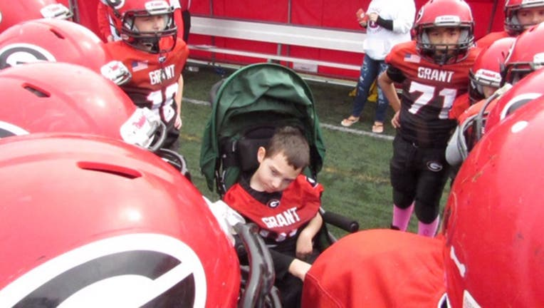 The Grant Jr. Bulldogs youth football team in Fox Lake, Ill., made Bryson Jenkins, who has cerebral palsy, the honorary captain on October 5 and now he is officially considered part of the team, Brittany Jenkins, Bryson's mother, said. (Brittany Jenkins)
