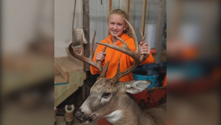 Lilly Mickelson, 11, poses with her trophy buck.