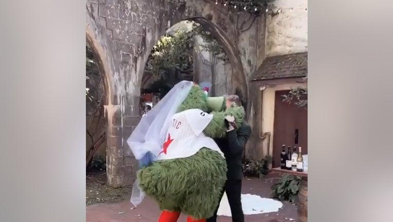 mascot-kisses-groom.jpg