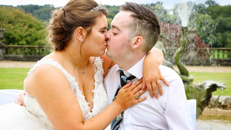 The pair got engaged shortly after doctors told Harrison there was nothing more they could do to treat his brain tumor. (SWNS)