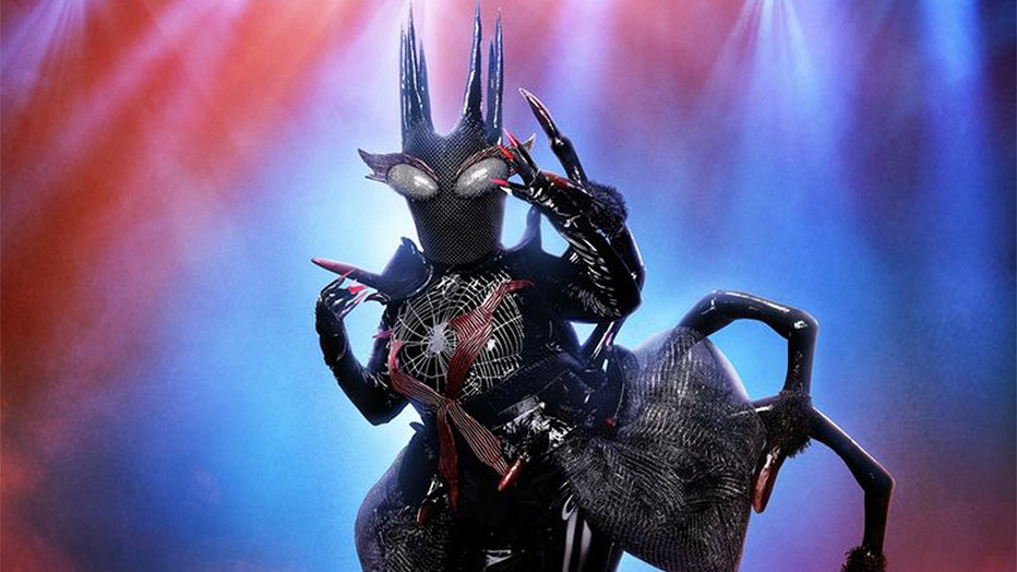 "Crawl to your television screens to catch the black widow on ""The Masked Singer"" Wednesdays on FOX at 8 p.m. ET/PT."