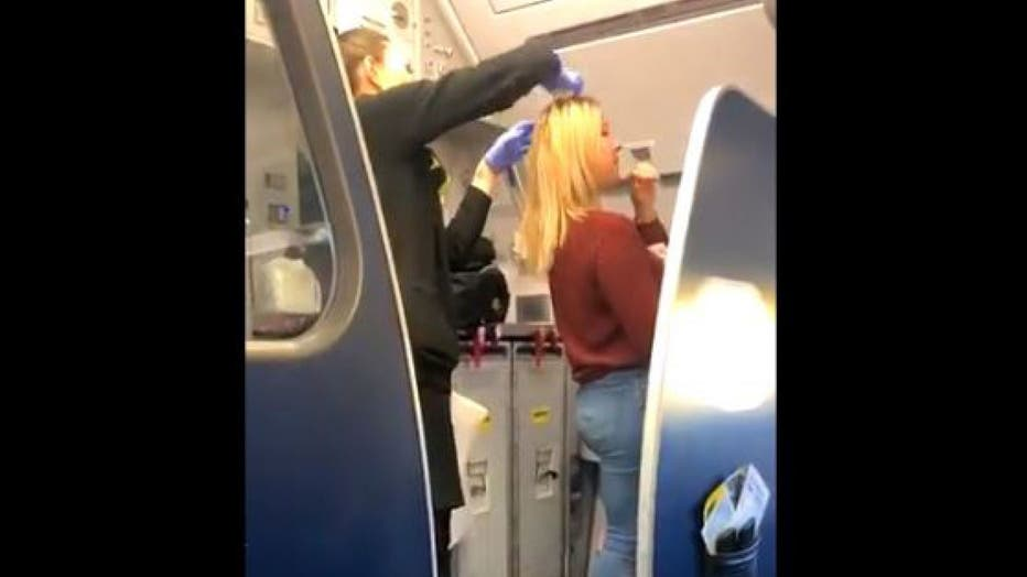 The female passenger was tended to by flight attendants. According to nearby passenger Cassidy Smith, the woman was forced to wash her hair in the bathroom sink.