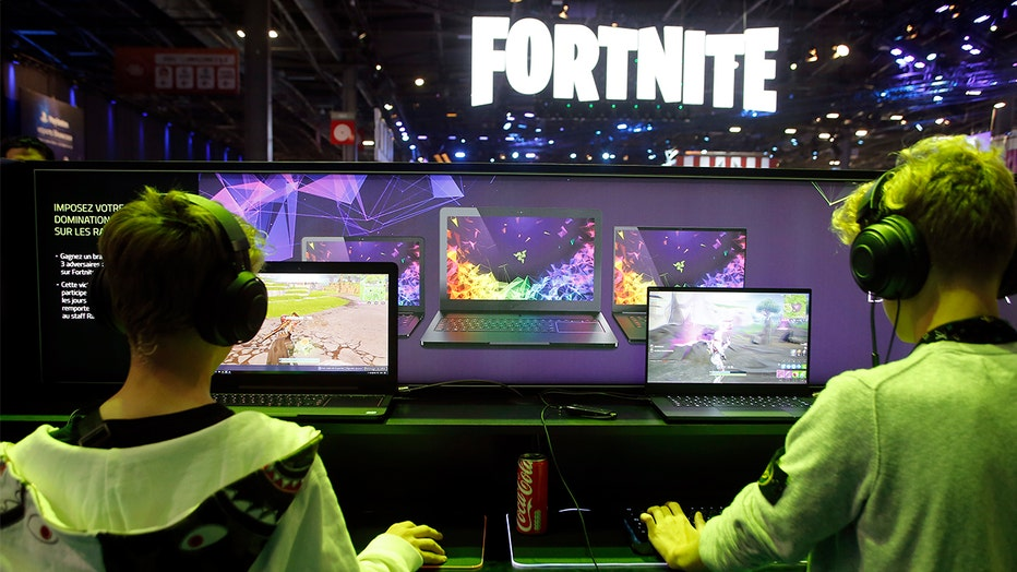 Gamers play 'Fortnite,' developed by Epic Games, during the 2018 'Paris Games Week' in Paris France. A lawsuit has been filed against Epic Games alleging the company 'knowingly' made an 'addictive game.'