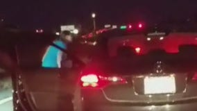 Caught on camera: Woman gets out of car, throws drink at another vehicle in traffic