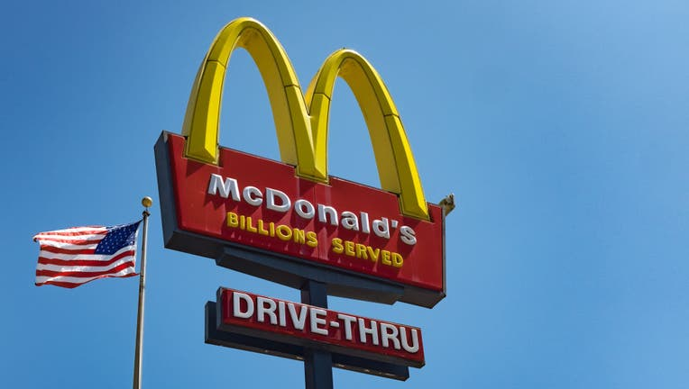 The sign for McDonald's drive in take-away restaurant and an American flag in the Silver Lake area of Los Angeles. (Photo by Epics/Getty Images)