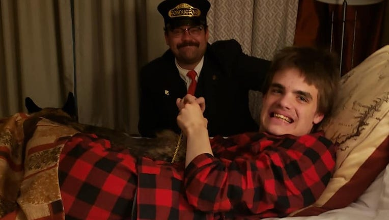 Ty Swartout with the Polar Express conductor
