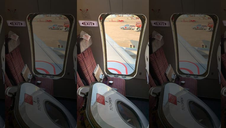 """A spokesperson for Thai Smile Airways has apologized after a """"crazed"""" passenger, who was reportedly drunk when he ripped an emergency exit door open just moments before takeoff. (ViralPress)"""