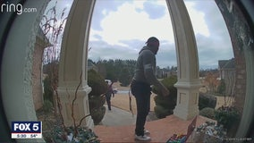 Camera catches delivery drivers' priceless reactions to holiday surprise