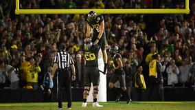 Herbert has 3 TD runs, Oregon beats Wisconsin in Rose Bowl