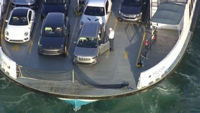 Women who died inside Mercedes that rolled off Florida ferry were found embracing: report