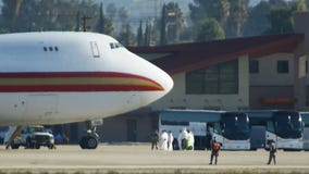 2 planes carrying American coronavirus evacuees held in California, Canada over 'persons of interest': sources